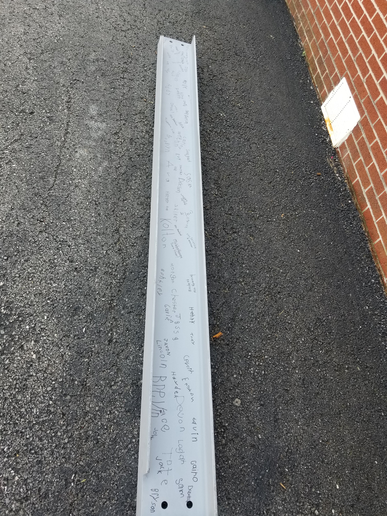 The beam signed by the students and staff at Noble Elementary.
